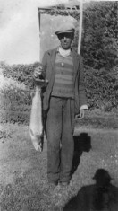 Fisherman with his catch c.1930