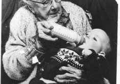 Barbara Clancy {Wellfield} at the age of 102 feeding her great grand niece, Mary Molloy, Tullykyne.