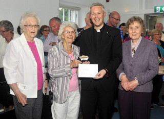 Fr Alan with Mary Maguire, Eileen Lydon and Tess Maloney. | Tom Broderick