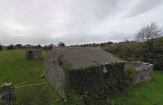 View of some outbuildings on opposite side of road
