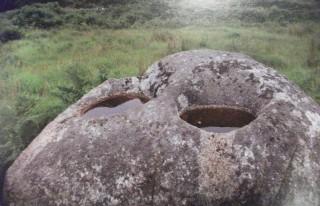 Double bullaun stone