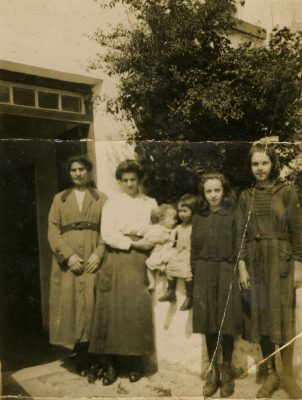 From Left:  unknown, Bid Fahy, Jim O'Connor, Julia O'Connor Goodall, Winifred O'Connor Faherty, & Mary O'Connor Higgins  Taken Circa 1922 outside their house on Camp Street | Padraig Faherty