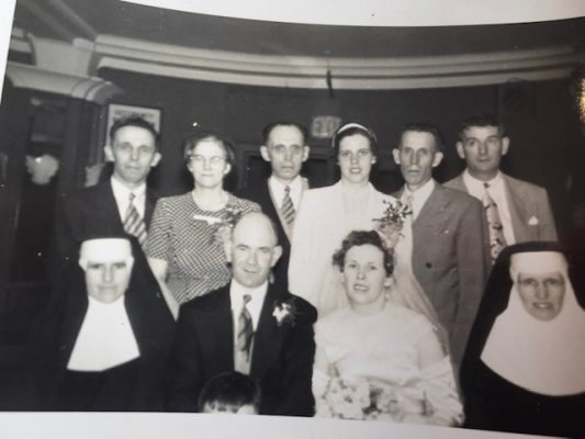 Gertrude's wedding in the 1950's. Sr. Vianney (Bridget) is next to Gertrude. Back row left to right is Michael, John and Patrick. | Mary Pleyo
