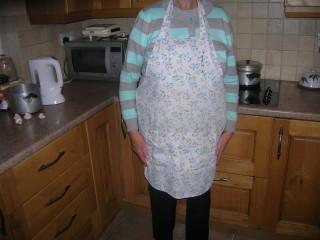 Una's pale blue and white apron