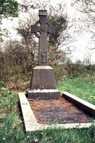 The grave of  Rev. John Connolly former parish priest of Killannin which is at the rear of the church.