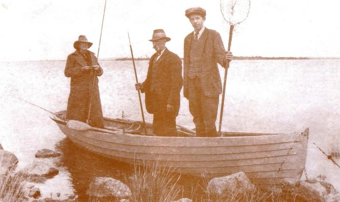 "Circa 1931. On the Island Of Inishool, with Malachy's Island in the background. To the left is Kingsmill Moore, Senator, High Court Judge, fisherman and author. He is accompanied by Jamesie and Bill Donnellan, both of whom he mentioned in his famous book ""A Man May Fish"". 