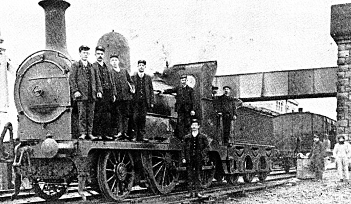 Train at Oughterard Station. The Station Master is second on the left