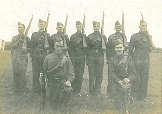 A group from Oughterard Company FCA (Local Defence Force) who won an inter-Company Drill competition in Co Galway in 1941. Left - Right: Paddy Darcy, Jack Fahy, Paddy Heffernan, Frank Gibney, Mick Joyce, Martin Molloy and Joe Lydon. Kneeling: Paupe Joyce and Jim Connor - the officers in charge.